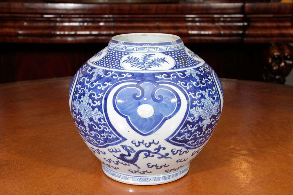 A Chinese blue and white porcelain jar with an abstract design.