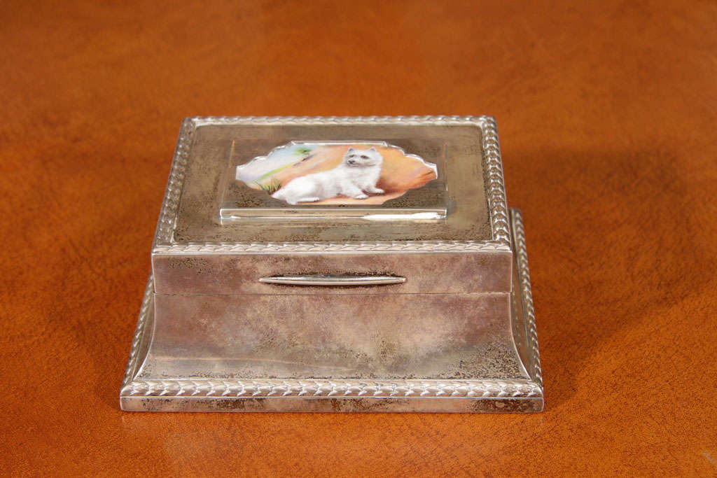 Silver box with painted shell inlaid on lid.