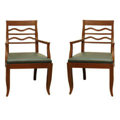 A Pair of Walnut Arm Chairs