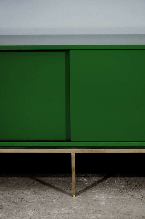 re: 379 Green Lacquered Sliding Door Credenza on Satin Brass Base In Excellent Condition For Sale In New York, NY