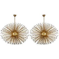Pair of oval brass chandeliers