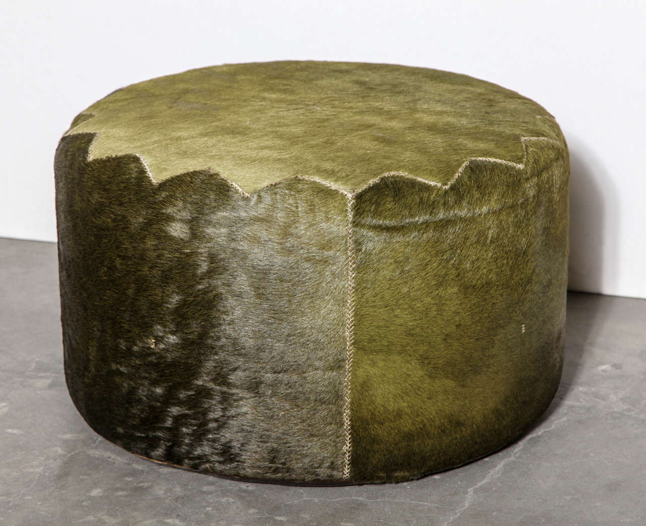 Unique green cowhide Casablanca pouf by Henry Beguelin. Hand-stitched detail.