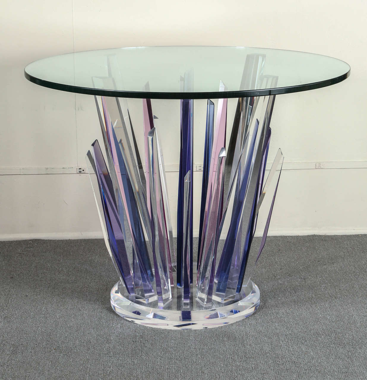This stunning stalagmite lucite table is made up of clear,  magenta, pink 