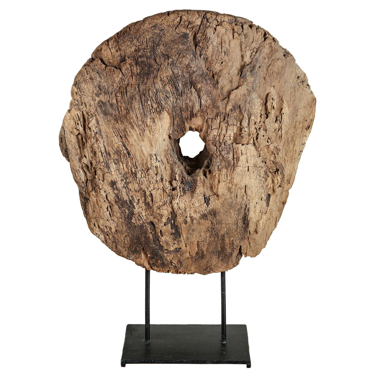 Giant reclaimed wooden disc with display stand for exhibit