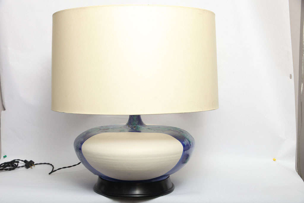 A pair of 1960s Danish sculptural ceramic table lamps, crafted of glazed ceramic with lacquered wood bases. Shades not included