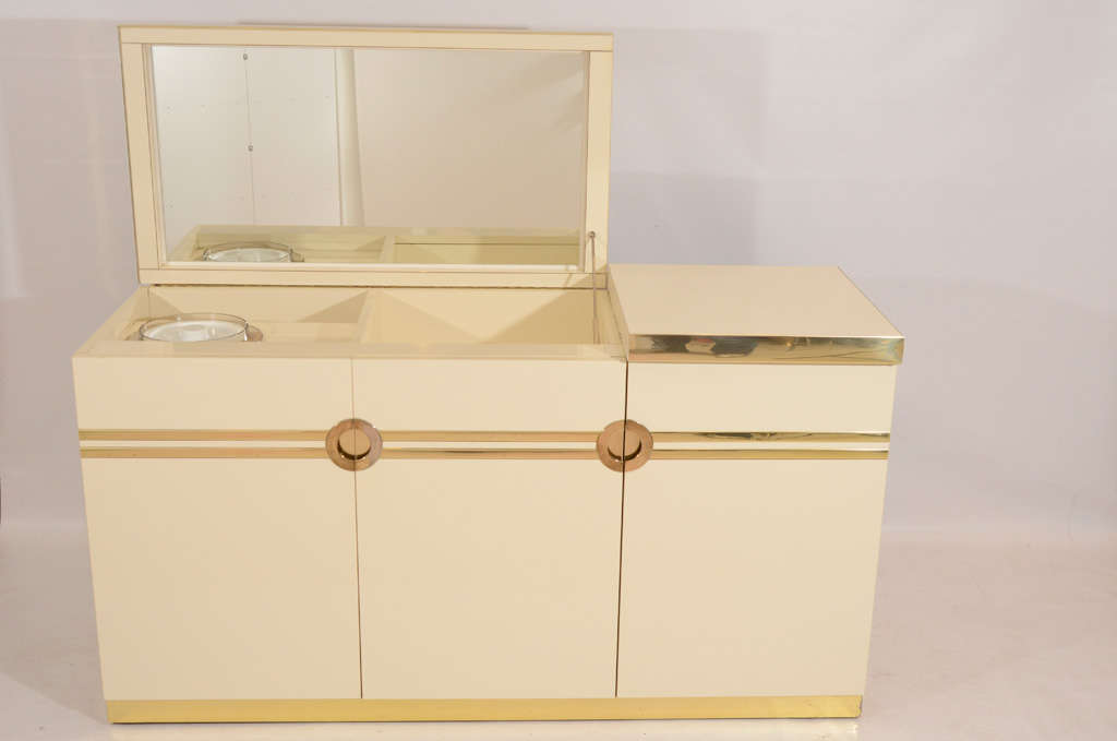 Very stylish credenza designed and signed by Pierre Cardin. The top lifts up to reveal a mirror and bar interior with an ice bucket. Chic! Please contact for location.