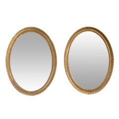 Pair of 18th Century English Oval Gilt Mirrors