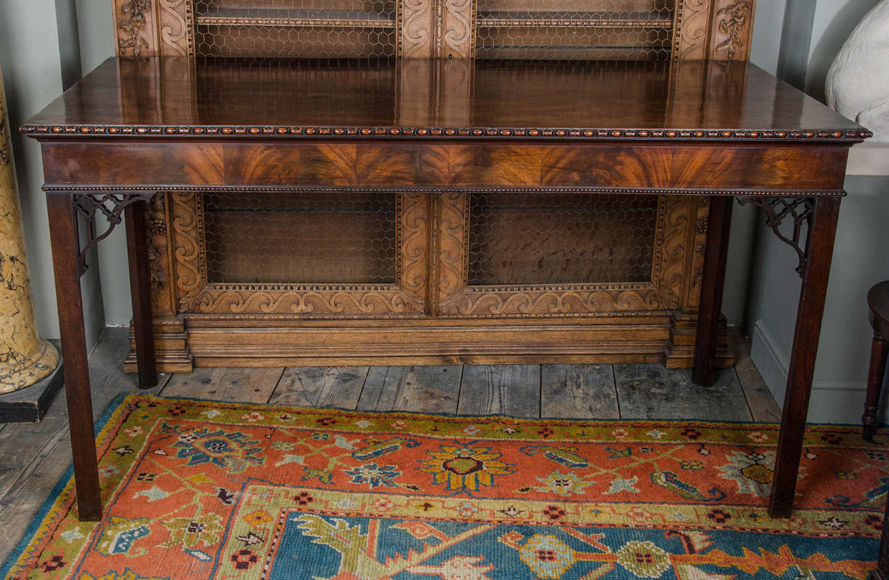 Table having a well figured rectangular top above a guilloche moulded frieze, on chambered legs.