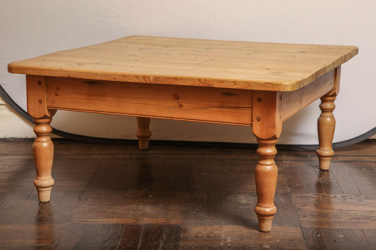 Low pine coffee table with turned legs at stdibs