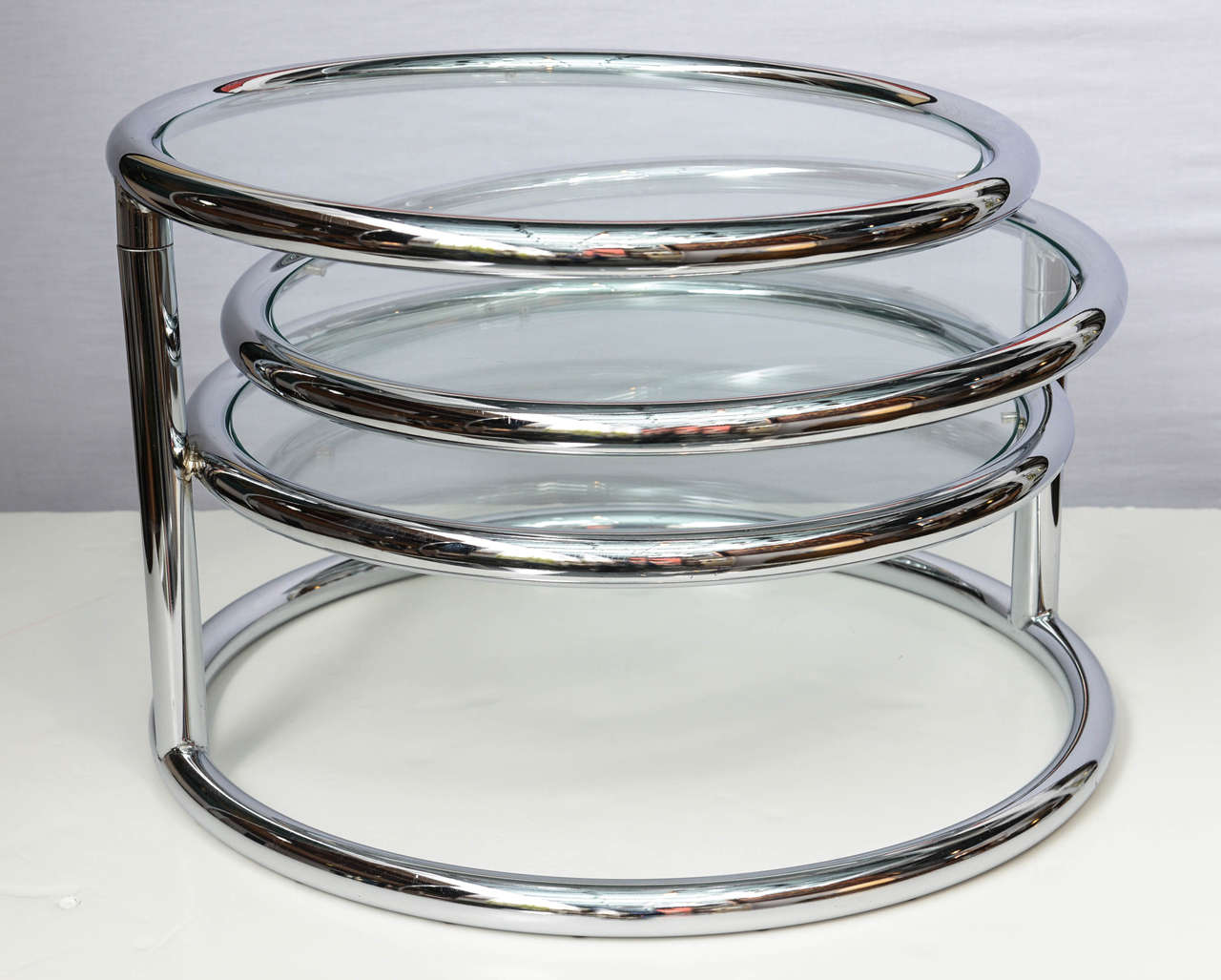 Options never cease with this wonderful coffee table. Three tiers of polished chrome tubular framed and glass easily fold and open to your need and pleasure. It can be used as a side table as a coffee table when is totally open and works well with