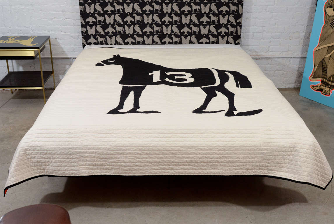 Queen-size Dylan Egon quilt with hand-sewn image of a horse and the number 13.