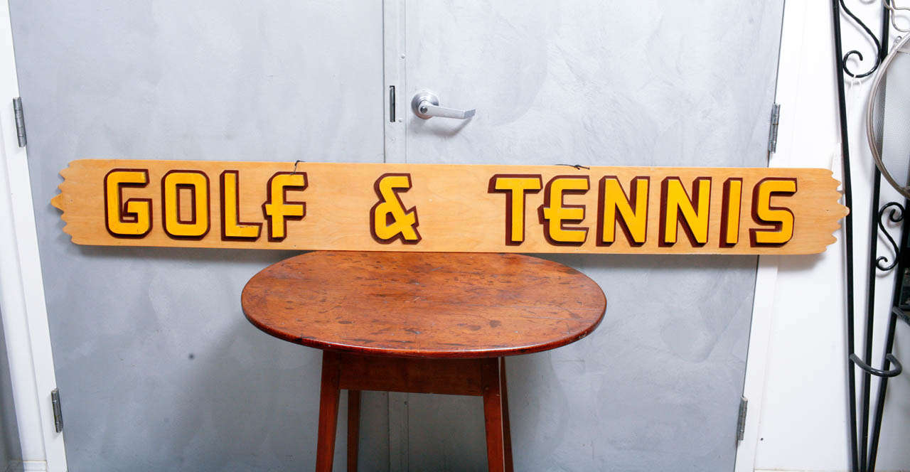 This is a delightful piece of mid-century signage that we were thrilled to find. This piece is one of those hard to find gems that you cannot pass up. It seems to be a relic from a 1950's country club or sporting goods store. The articulated raised