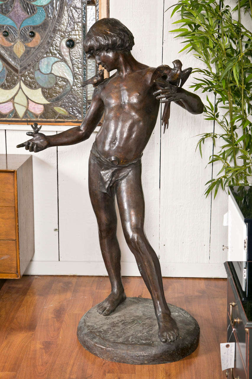 This Statue Is Beautifully Done In Bronze Large Boy With Three Diffe Birds On His