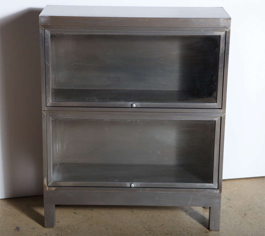 pair of restored steel Barrister Bookcases with glass fronts. Can be stacked. Multiples available with notice.  Ideal multi-use, dust free storage piece.  Great storage for small, compact space.  Can also be considered for Kitchen, Dry Bar, Linen