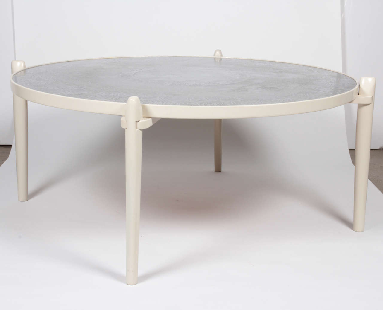 Circular Coffee Table Etched Aluminum, White Feet In Wood.