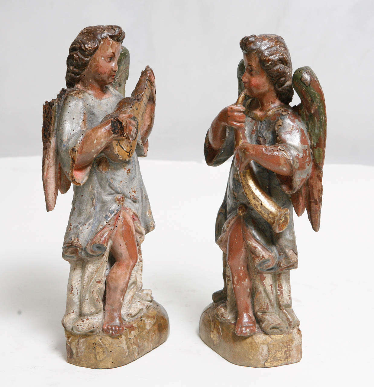 18th c. Pair of Italian Polychromed Winged Angels playing Instruments. The base measures 5.5 inches