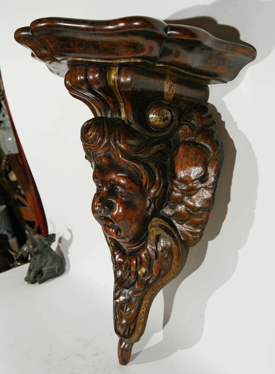 19th century Italian Carved Cherub Head in Walnut Wall Mounted Console.