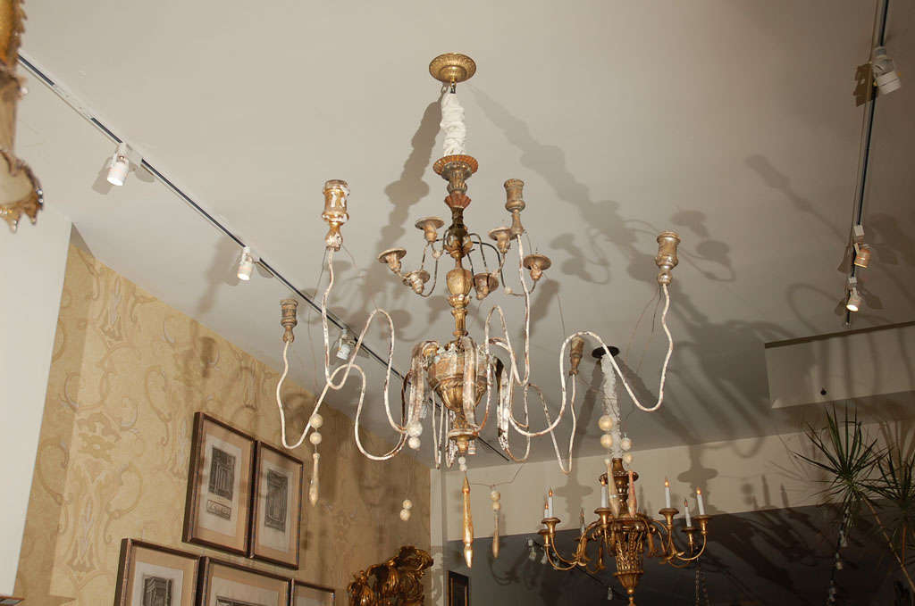 Italian carved wood and iron twelve- light chandelier (non electrified).