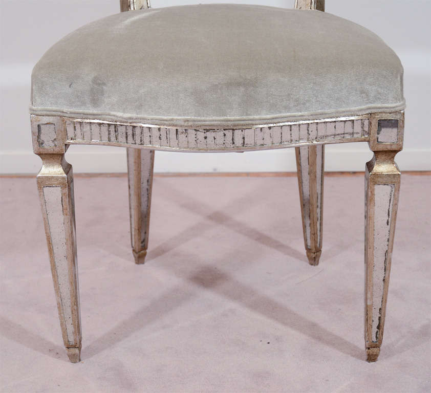 pair of vintage hollywood regency style mirrored chairs at
