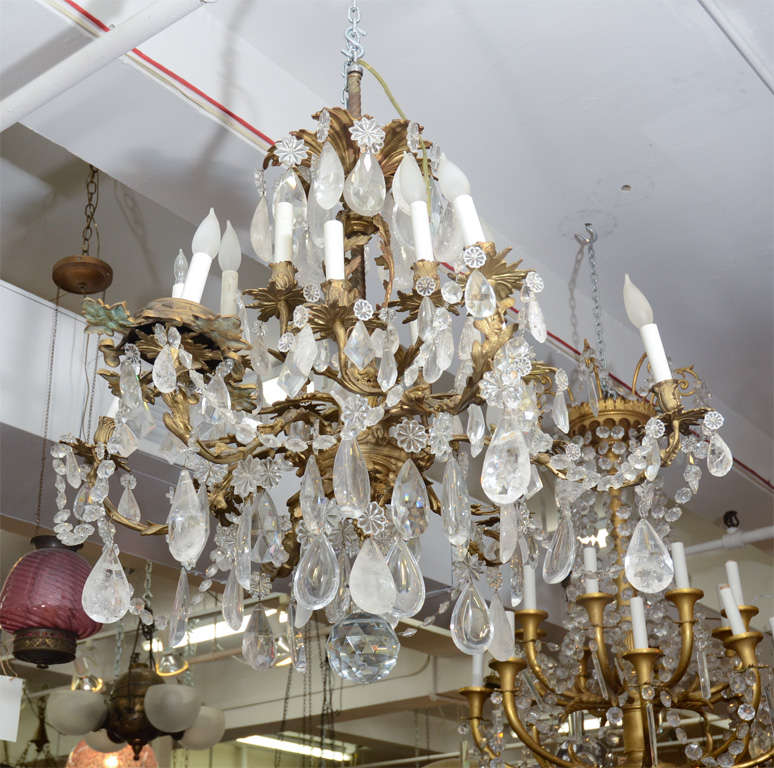 A large, elaborate bronze chandelier with vegetal detailing adorned with  clear rock crystals. - Antique 19th Century Bronze And Rock Crystal Chandelier At 1stdibs