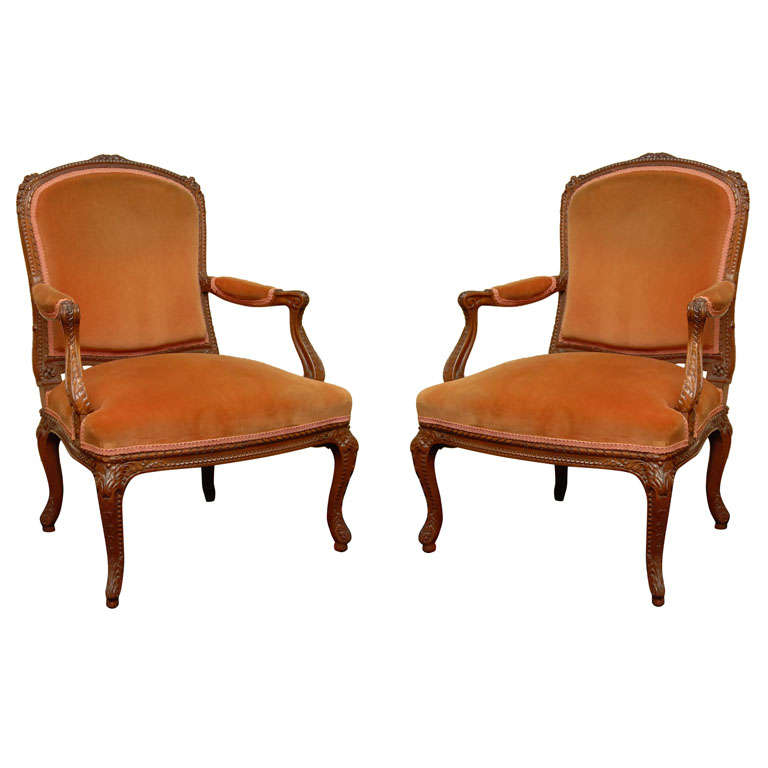 Pair of French Carved Fruitwood Armchairs