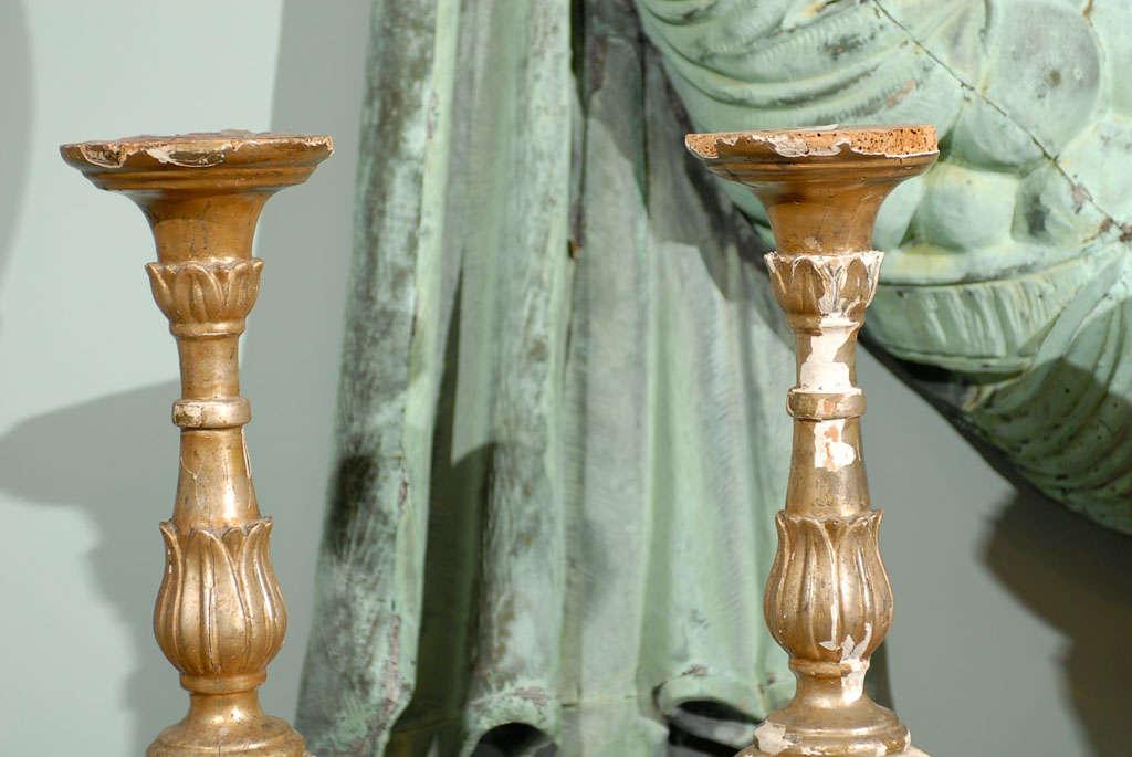 Pair of Italian 18th Century Giltwood Altarsticks In Fair Condition For Sale In Atlanta, GA