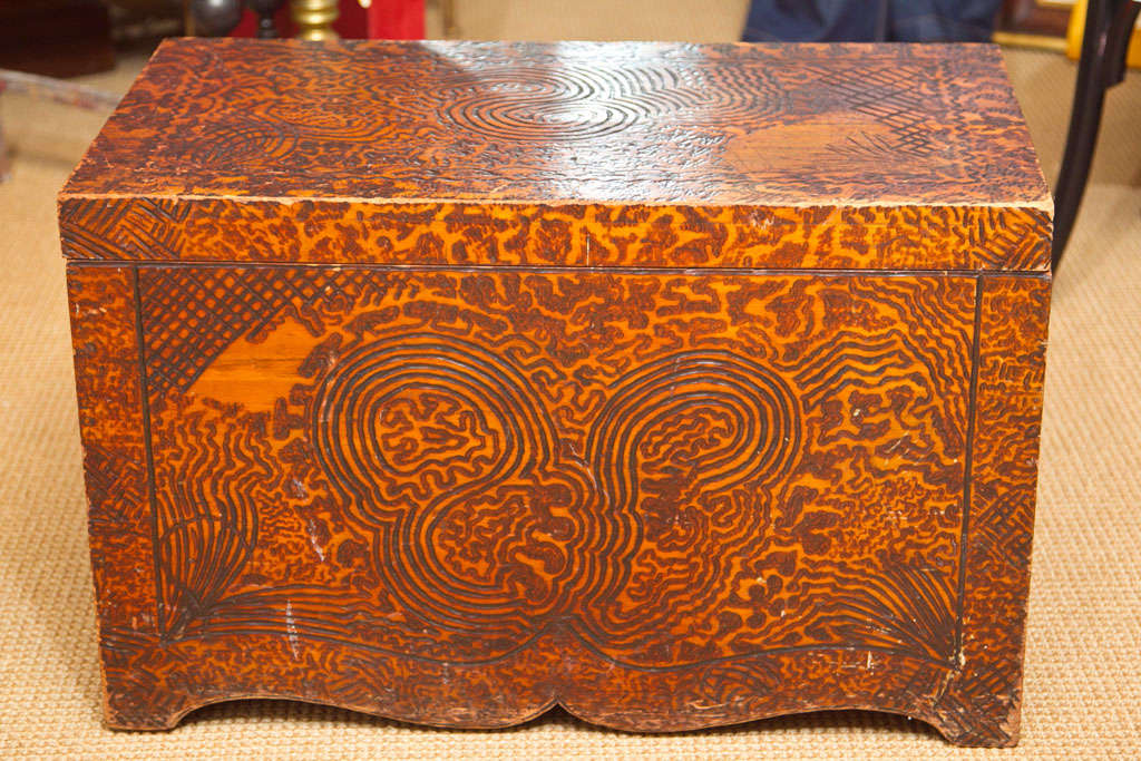 Wood burned (pyrography) chest with free-form design.