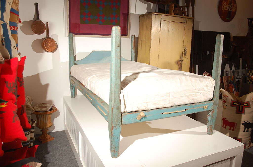 Fantastic original painted 19th century robin egg blue pencil post hired hands rope bed with a homespun mattress cover with custom-made mattress. The mattress is made of down and feather wrap with a foam insert. Great for a youth bed or guest bed in