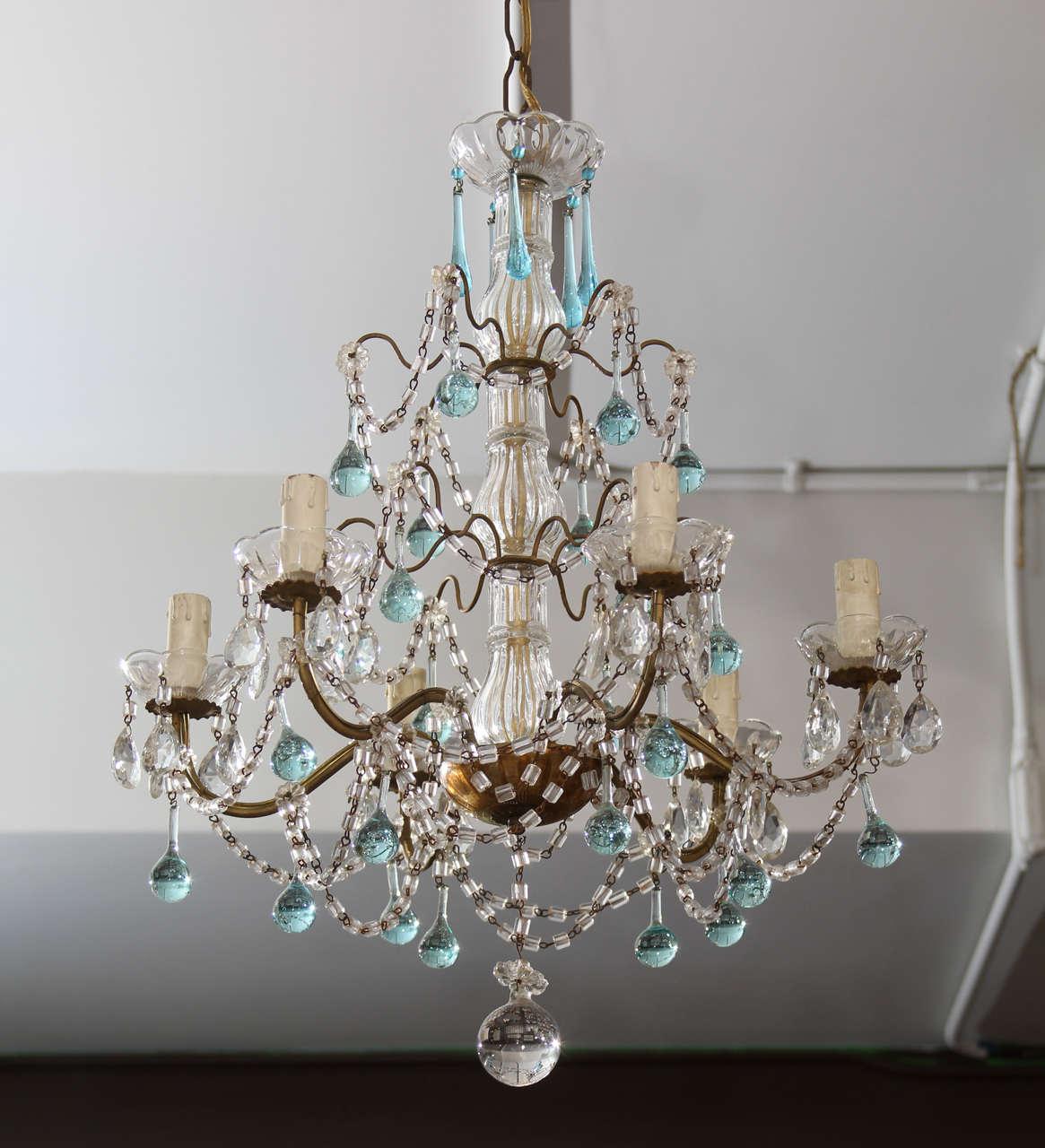 Very pretty six-arm glass chandelier with sea blue glass drops.
