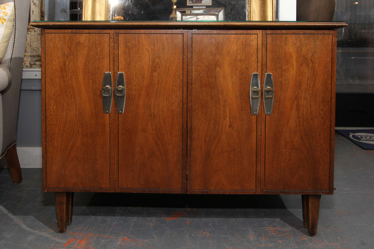Mid-Century American buffet that opens to hold one, two or all three leaves. Leaves store within buffet or sideboard and there is a generous drawer to hold linens and tableware. Perfect for small space living or the perfect extra table for extra