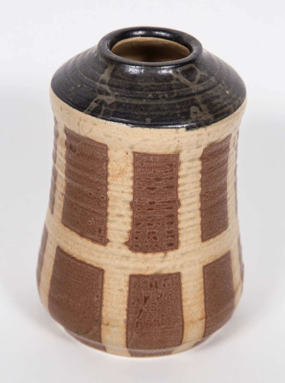 Matte glazed studio pottery with graphic checker pattern.