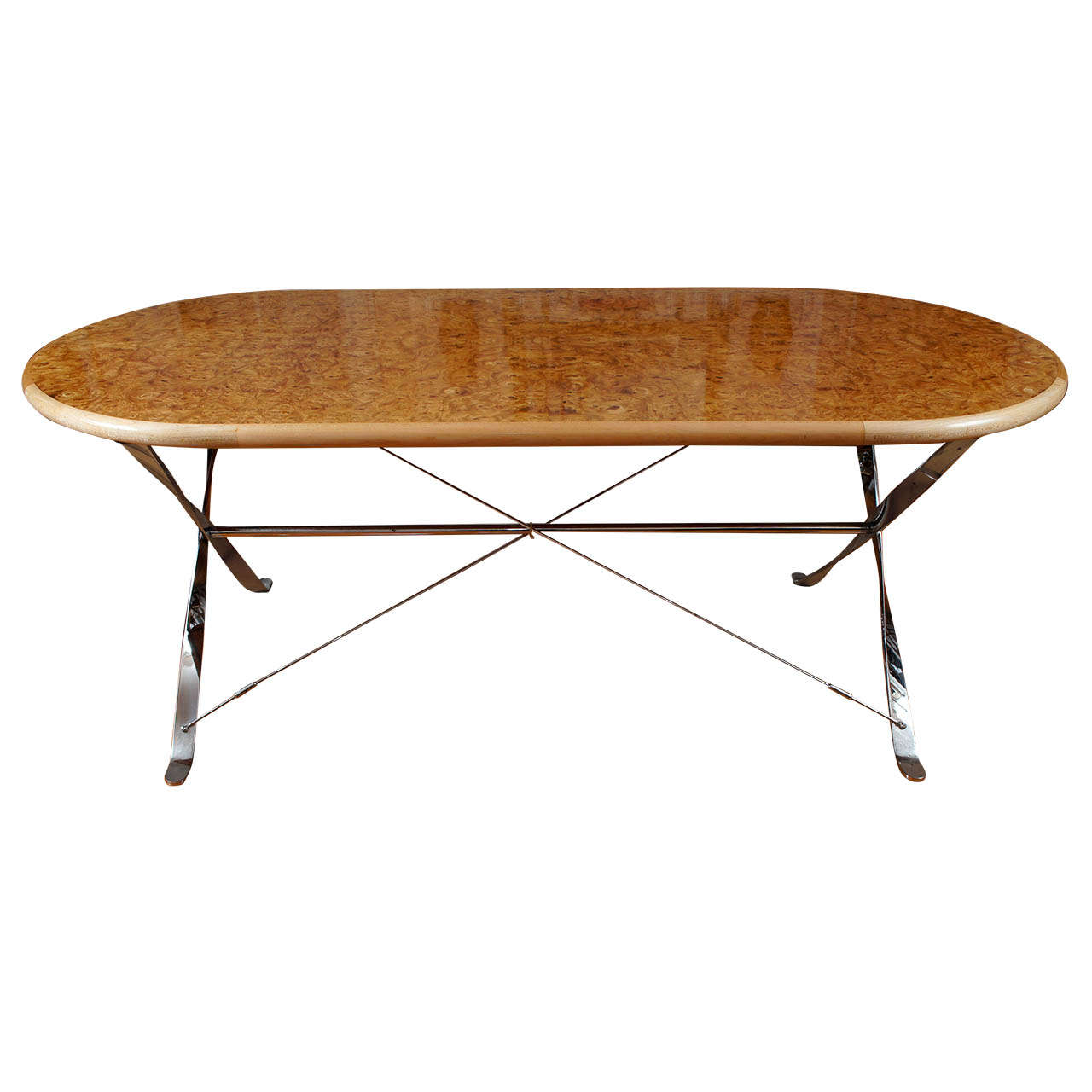 oval burl maple dining table on stainless steel base at