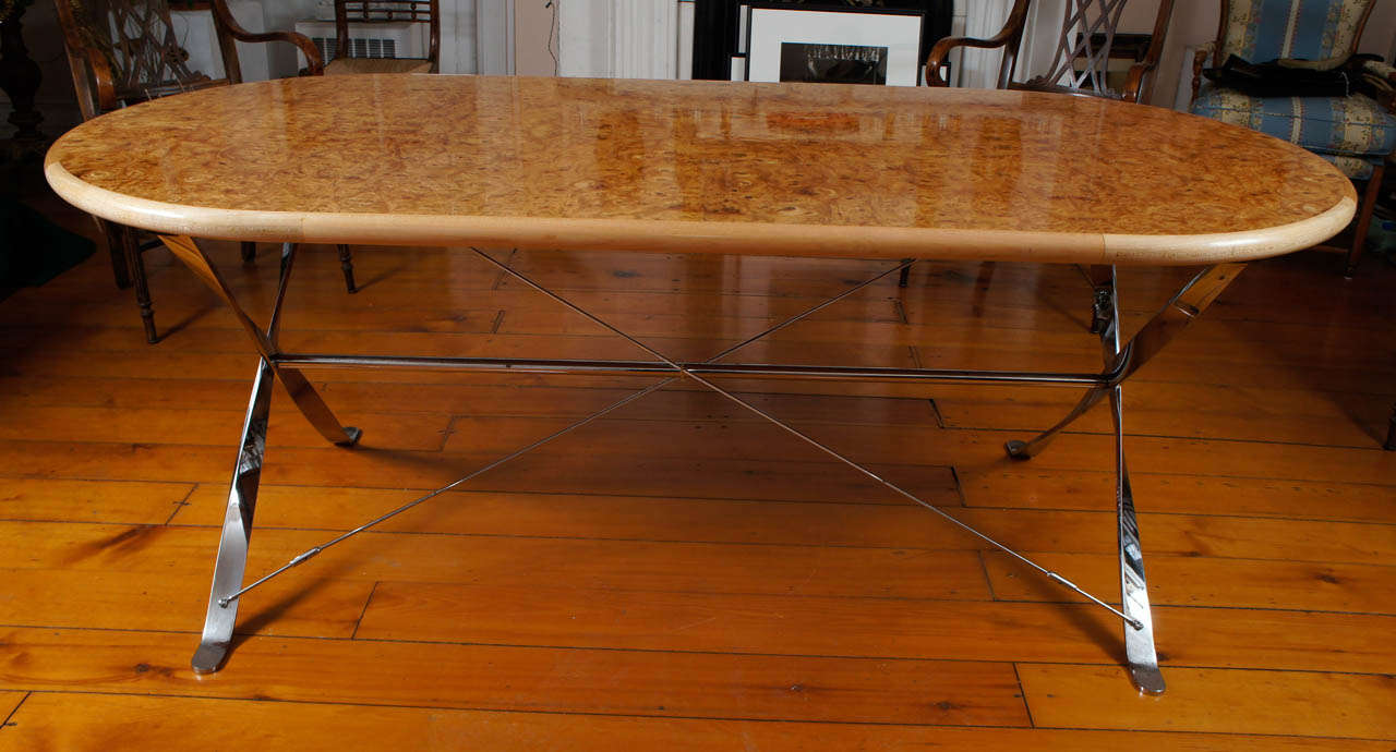 oval burl maple dining table on stainless steel base for