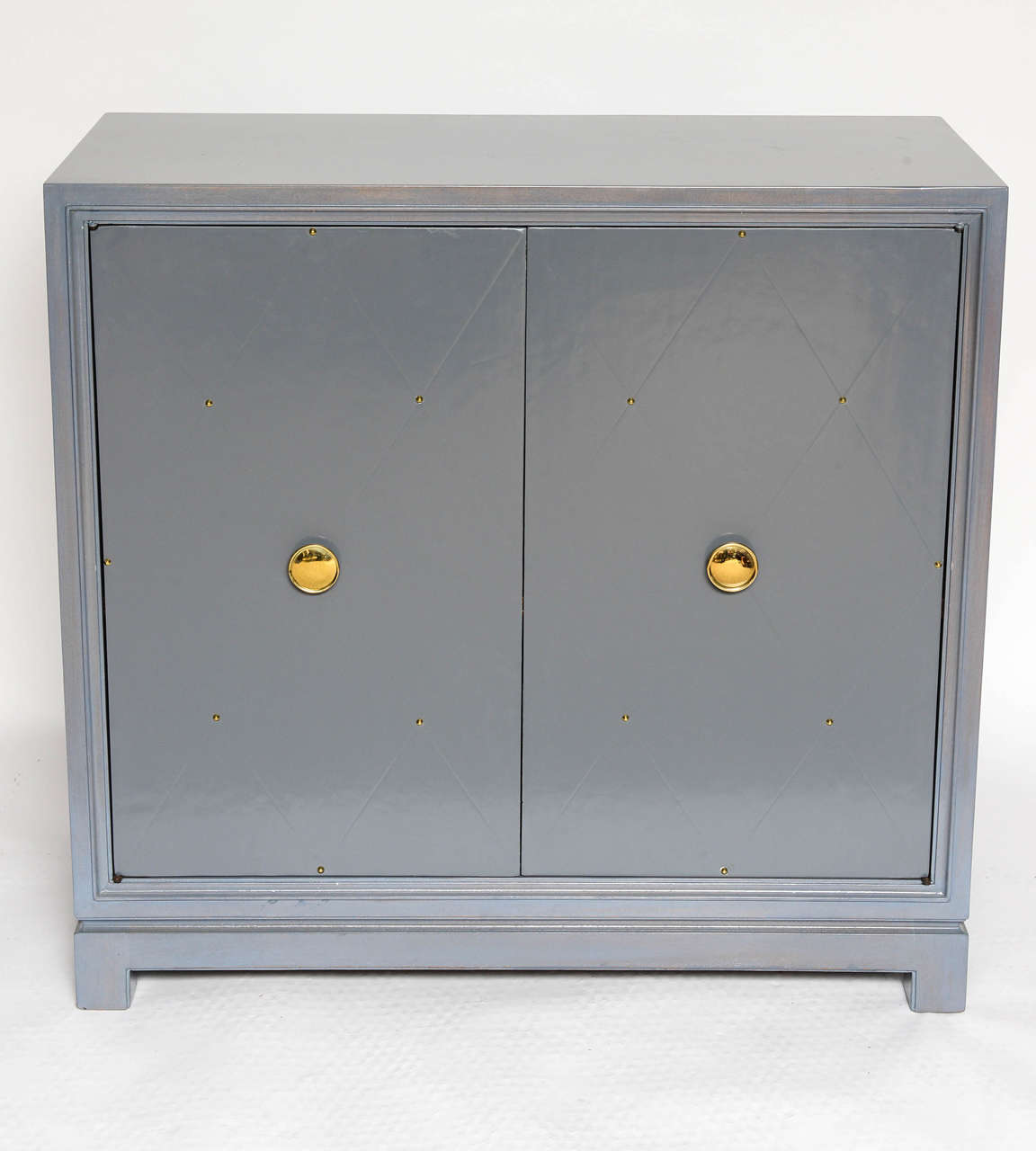 Identical from the outside, this pair contains one cabinet with shelving and one with drawers. Label to interior.