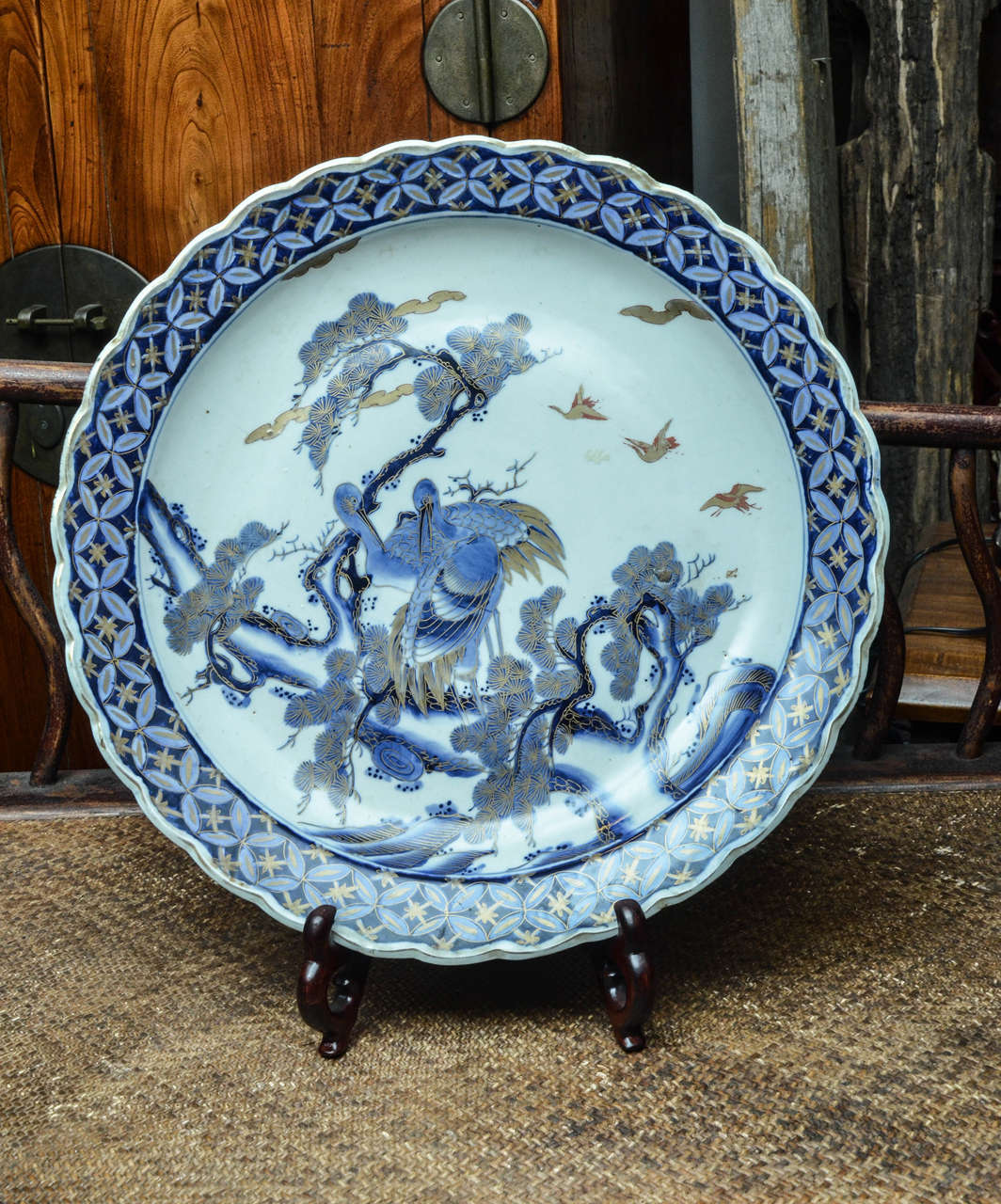 Mid-19th century Japanese porcelain blue and white imari charger with gold leaf overlay.