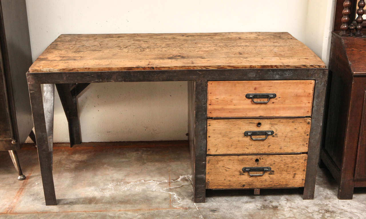 19th century desk in metal with wood top and drawers at