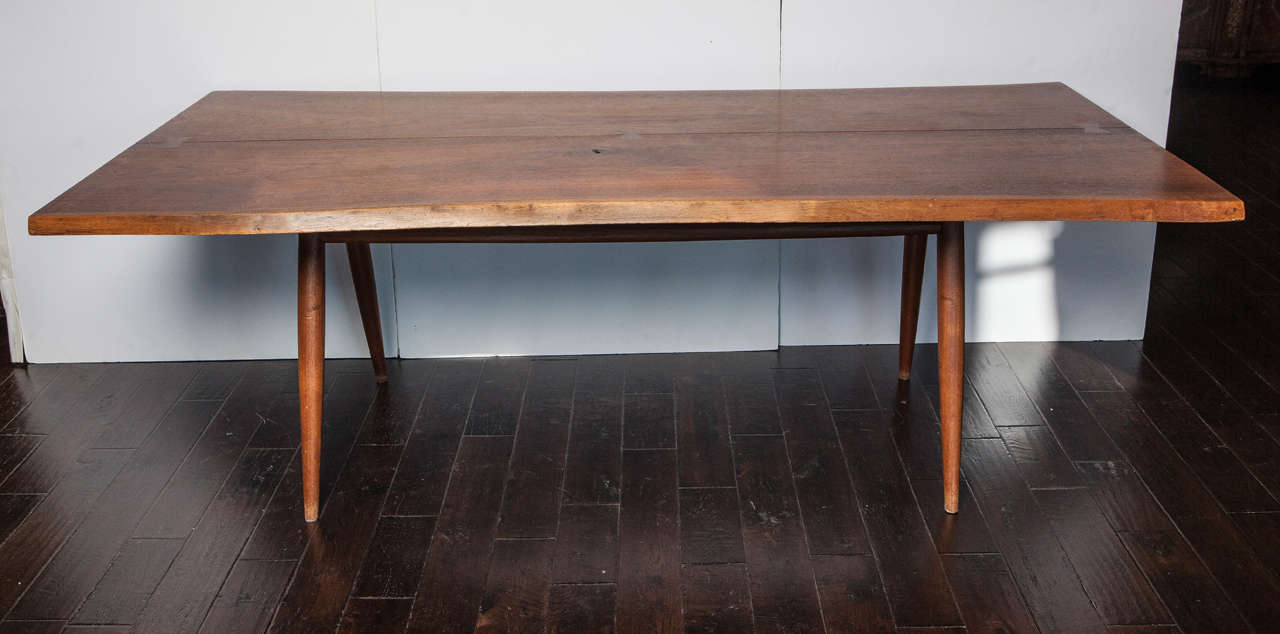 Free edge walnut dining table custom-made by George Nakashima. Top comprised of two walnut boards with two free edges and three butterfly keys. Four turned legs with two stretchers. Made in Pennsylvania, 1956. Proof of provenance provided.