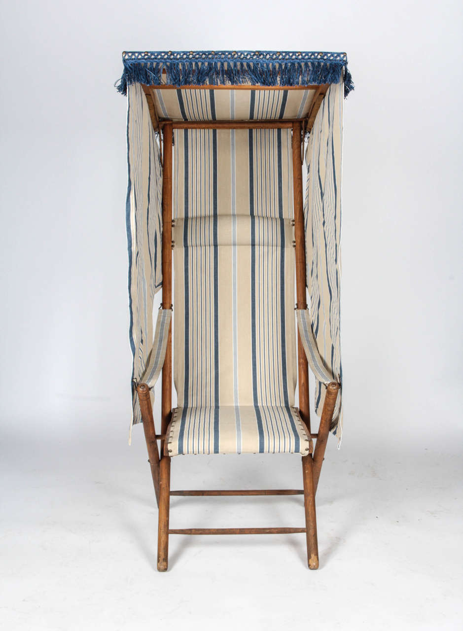 Early 20th Century Beach Chair. Folds Flat. Recently Reupholstered. Not  Available For Sale