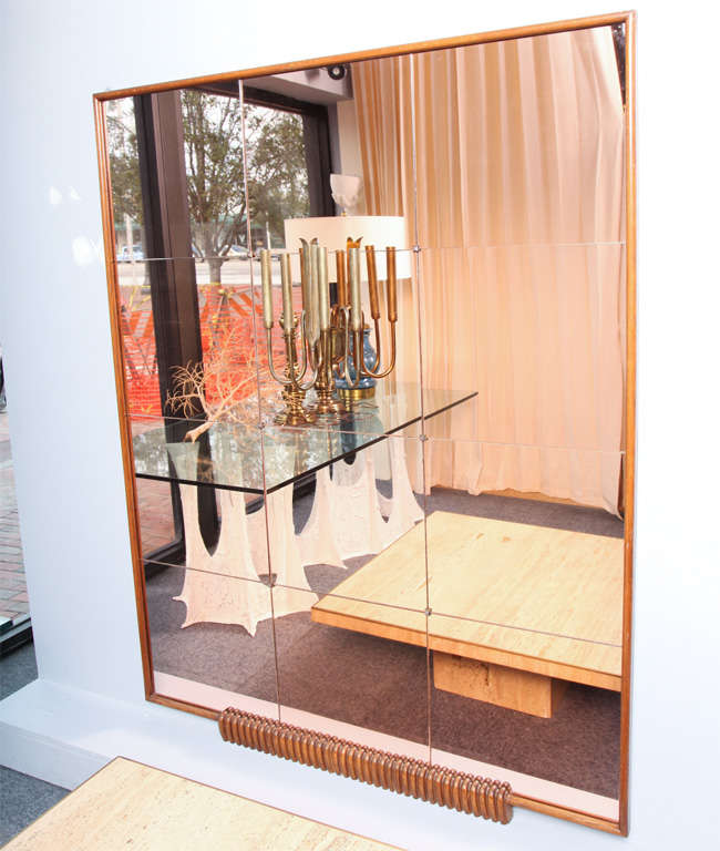 Very important walnut mirror by Osvaldo Borsani with 12 panels. Light stained Apricot mirror with brass corner details and 4-light sconce in center (original patina on sconce). Great foyer piece.