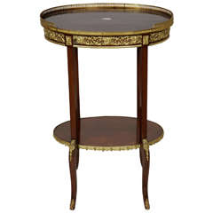 Transitional Style Ormolu-Mounted Mahogany Oval Shaped Two-Tiered Table
