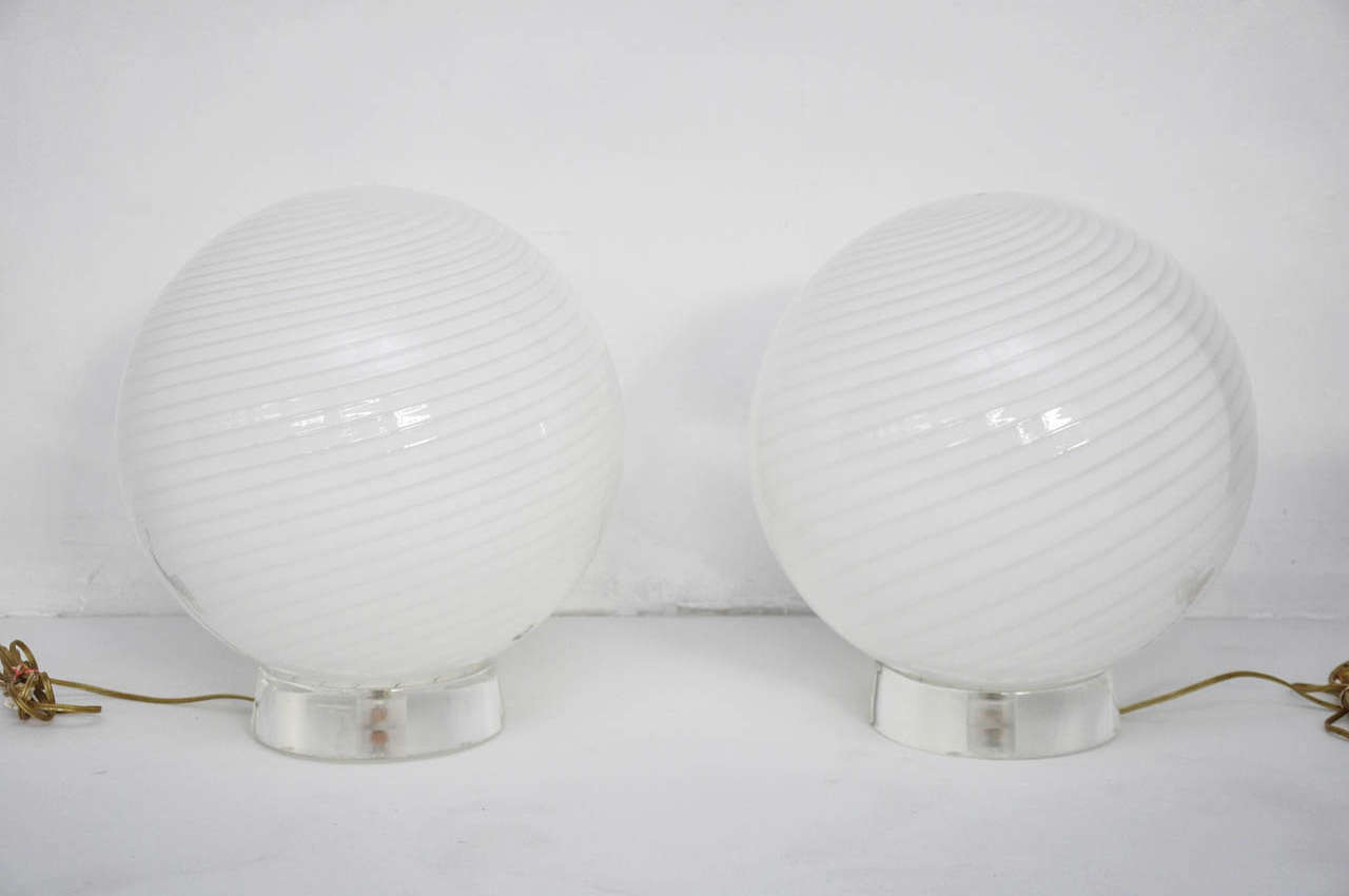 Large Murano glass orb table lamps by Vetri. Lucite bases.