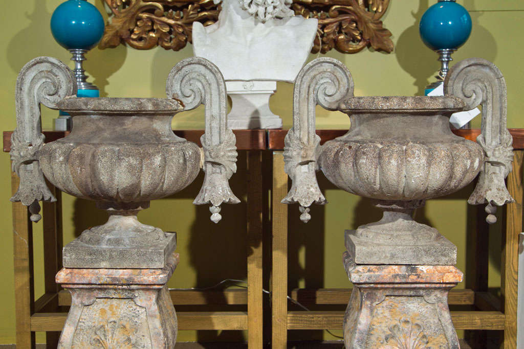 Gothic style urns with scroll form handles on square bases