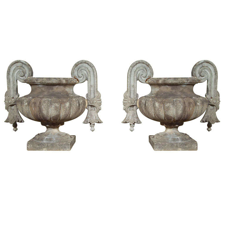 Pair of Composed Stone Urns For Sale