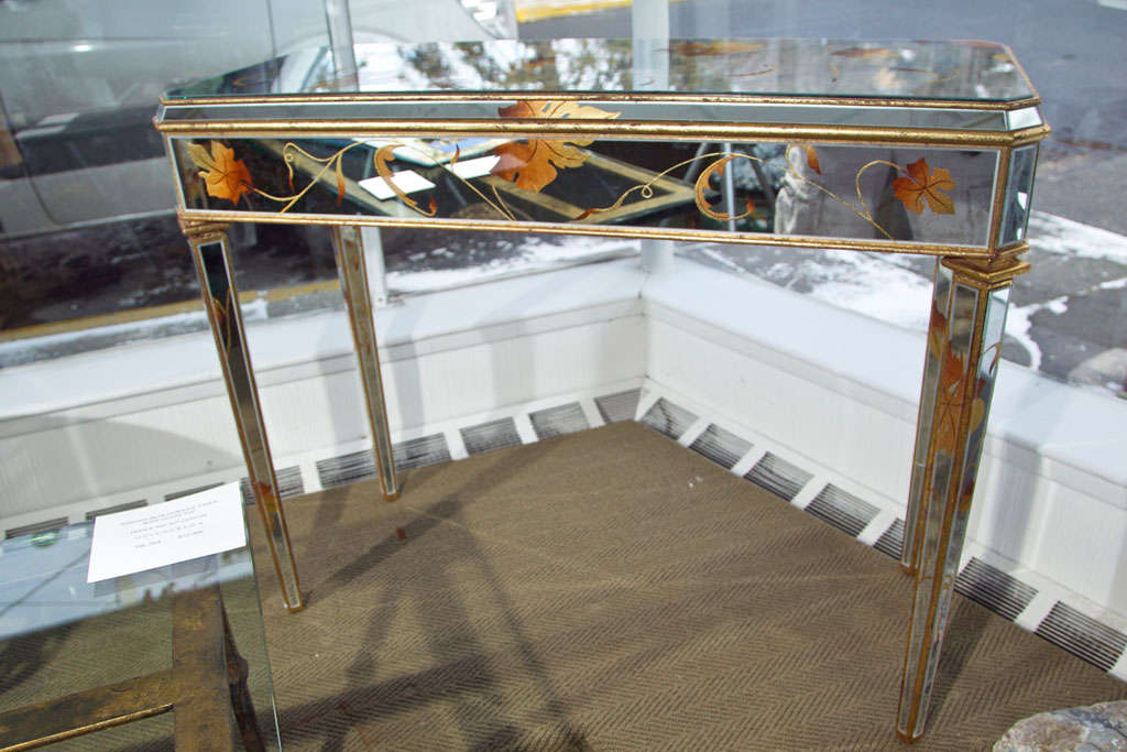 Gold & copper beechtree design mirrored glass over a wood frame with gilt wood edging