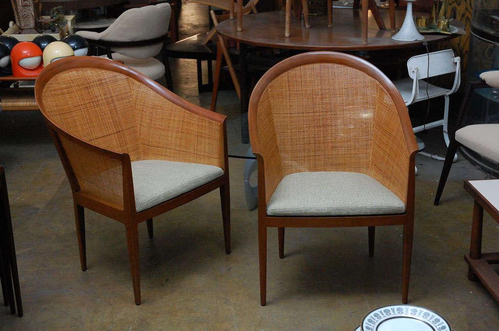 Very elegant cane armchairs by Kipp Stewart.