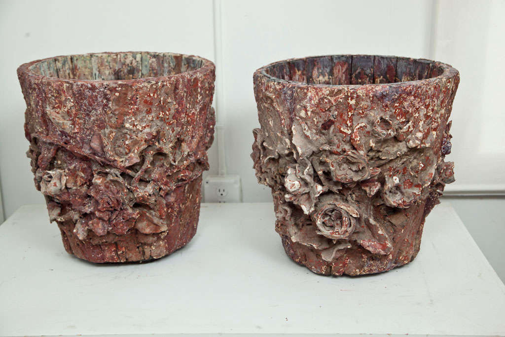 Pair of large wood water buckets with floral stucco appliques.