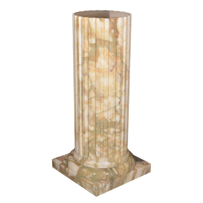 The fluted circular column supported by a square base for for Fluted pedestal base