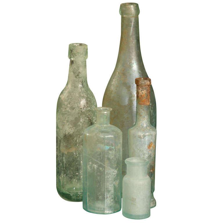 set of 5 aqua bottles