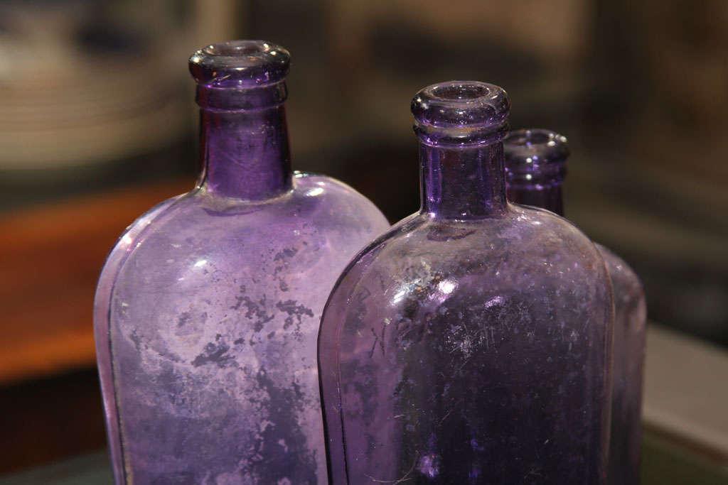 set of 3 purple bottles 10