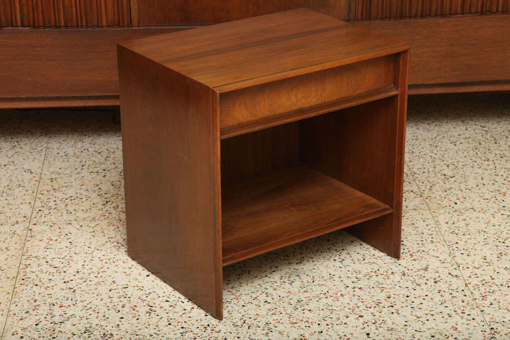 Beautifully figured walnut highlights this Robsjohn-Gibbings bedside table for Widdicomb. With an upper single drawer and open cubbyhole shelf below, perfect for a few favorite books. In very nice original condition, recently given a good polish